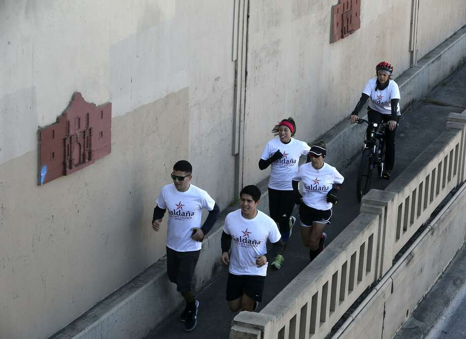 District four city councilman Rey Saldana (front, right) runs Thursday February 16, 2017 with a group of supporters down Nogalitos street. Saldana has made a tradition of running from his Southwest Side district to City Hall each election cycle to file for a place on the ballot in the May 6 election. He's running for his fourth term in office. Photo: John Davenport, Staff / San Antonio Express-News / ©San Antonio Express-News/John Davenport