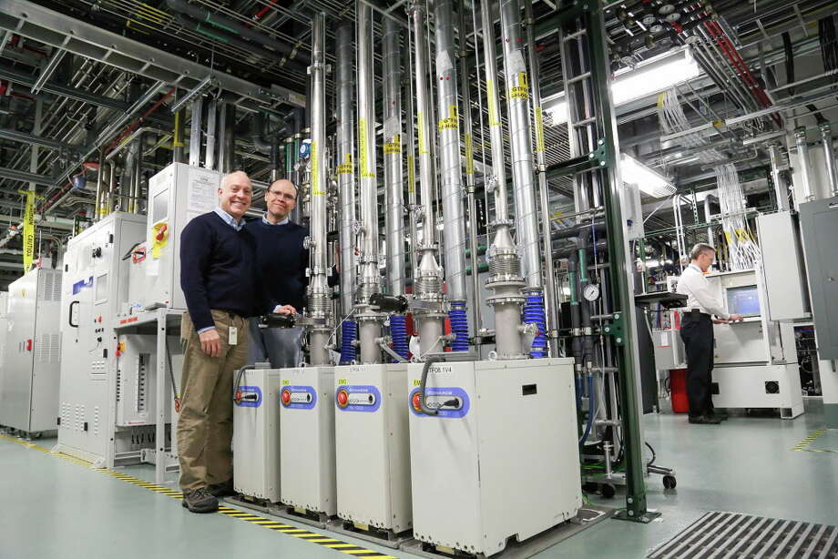 Michael Fancher, director of the NYS Center for Advanced Technology, left, is leading the Advanced Manufacturing Performance Center with  Eric Eisenbraun, center, and Tim Stoner, far right. Courtesy: SUNY Poly