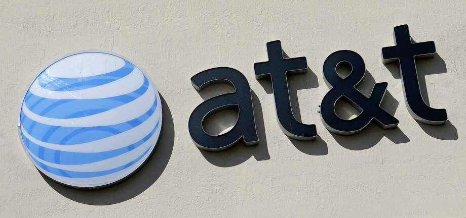 This Wednesday, Feb. 8, 2017, shows the AT&T sign at a store in Hialeah, Fla. AT&T says any cellphone customer can sign up for unlimited cellphone plans starting Friday, Feb. 17. That option had been limited to customers of AT&T-owned DirecTV. (AP Photo/Alan Diaz) ORG XMIT: NYJK501 Photo: Alan Diaz / Copyright 2017 The Associated Press. All rights reserved.