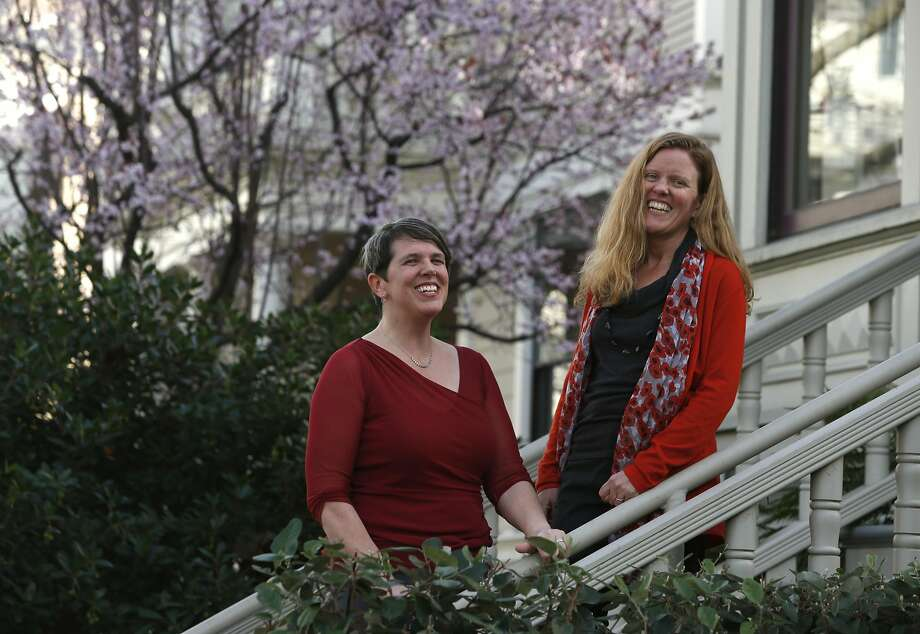 Hilary Abell (left) and Alison Lingane stand near their Project Equity office in Oakland. Their organization helps small, locally owned businesses figure out employee ownership strategies. Photo: Paul Chinn, The Chronicle