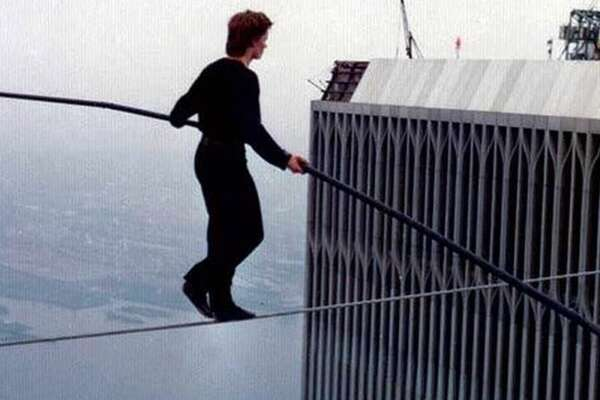 """#8. """"Man on Wire""""   Smart Rating:  93.04  Release year:  2008  Run time:  1 hour, 30 minutes  Using actual footage from the event seamlessly mingled with new re-enactments, filmmaker James Marsh masterfully recreates high-wire daredevil Philippe Petit's 1974 stunt: performing acrobatics on a thin wire strung between the Twin Towers of the World Trade Center. Plotting his feat like a master cat burglar, Petit enlists the help of a motley group of friends as he calculates every detail, from acquiring building access to stringing up the wire, and manages to pull off an astounding crime."""