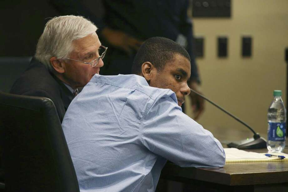 Darnell Rogers sits with his assisting attorney, Philip Bozzo, Jr, at the start of his attempted capital murder trial in the Bexar County 227th Criminal District Court, Thursday, Feb. 16, 2017. Rogers is accused of being in a shootout with Bexar County constables in September of 2015. Rogers is representing himself and has the aid of Bozzo, Jr. Photo: JERRY LARA, Staff / San Antonio Express-News / © 2017 San Antonio Express-News