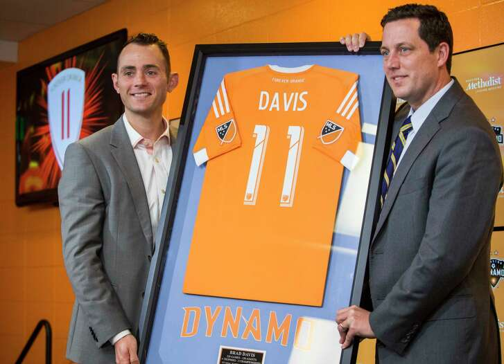 Longtime Dynamo midfielder Brad Davis, left, signed a one-day contract to retire with the team he spent a decade with Thursday. Davis, who was the club's leader in five categories, helped lead the Dynamo to two MLS Cup titles and two other Cup finals.