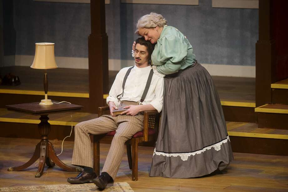Isaac Wood and Ann Russell-Lutenske rehearse a scene during dress rehearsal for Center Stage Theatre's production of Eugene O'Neill's 'Long Day's Journey into Night' on Thursday at Midland Center for the Arts. The play opens Saturday, Feb. 18 at 3 p.m. and will run Feb. 19, 25 and 26. Photo: Erin Kirkland/Midland Daily News