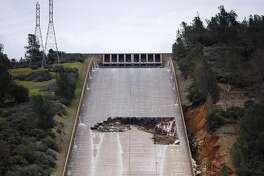A hole was torn in the spillway of the Oroville Dam while releasing approximately 60,000 cubic-feet-second of water in advance of more rain on February 7, 2017 in Oroville, California.