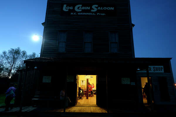 Visitors mingle in the Log Cabin Saloon at the Beaumont Heritage Society's Heritage Happy Hour event at the Spindletop/Gladys City Boomtown Museum on Thursday evening.  Photo taken Thursday 2/16/17 Ryan Pelham/The Enterprise