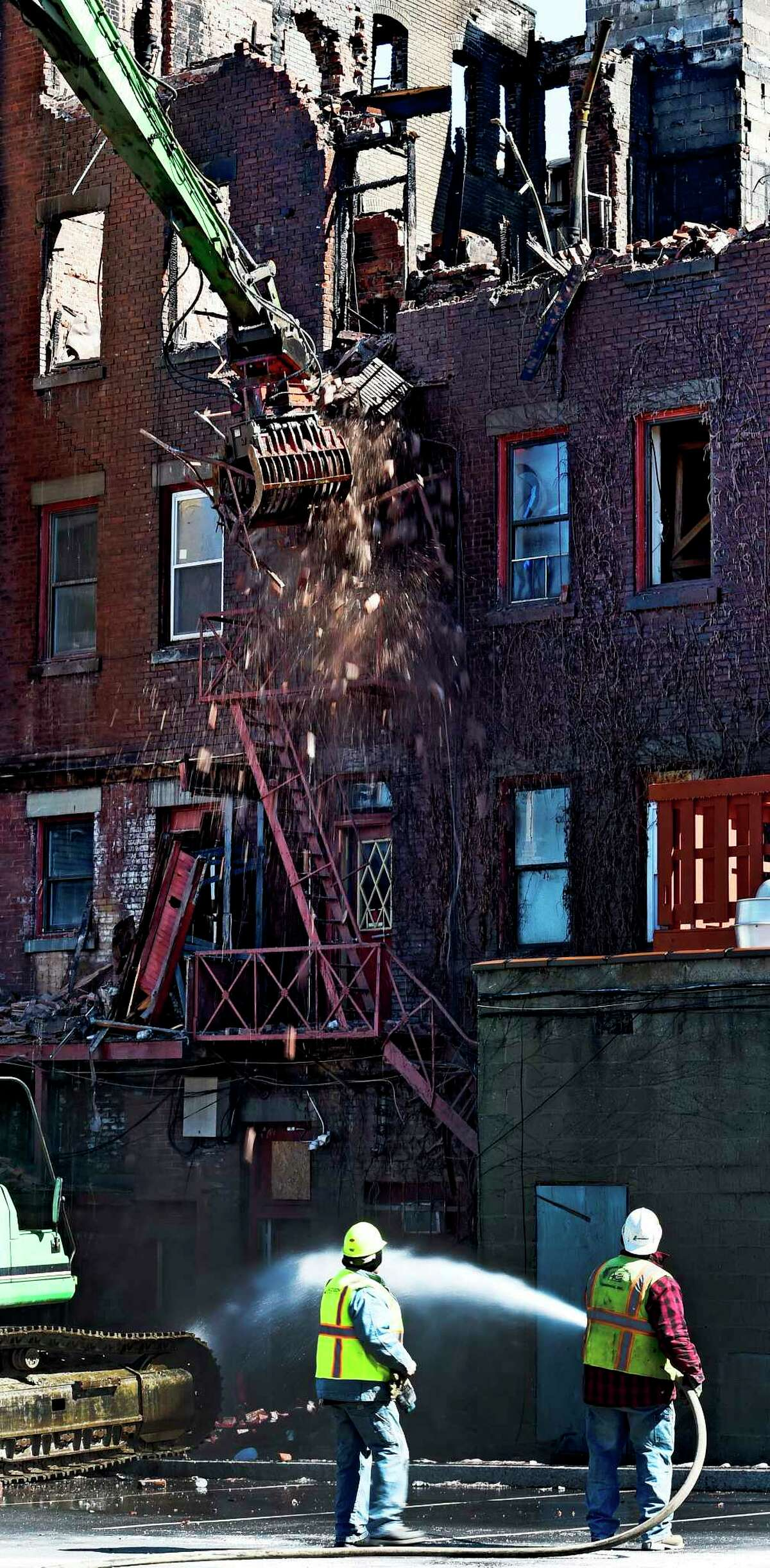 Demolition of 104 Jay Street commences Thursday afternoon, March 19, 2015, in Schenectady, N.Y. (Skip Dickstein/Times Union)