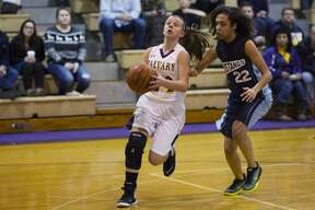 THEOPHIL SYSLO   For the Daily News Calvary Baptist's Courtney Warner controls the ball while being defended by West Highland Christian's Leila Abdallahi-Smith in a game at Calvary Baptist Academy on Thursday.