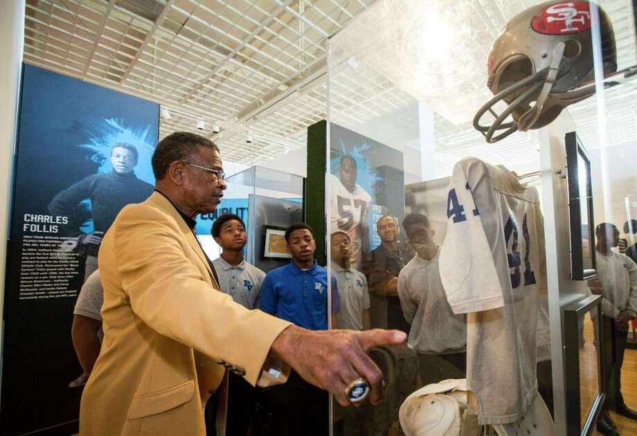 Pro Football Hall of Famer Kenny Houston, 72, leads students from Pro-Vision Academy through a tour of Gridiron Glory. Photo: Brett Coomer, Staff / © 2017 Houston Chronicle