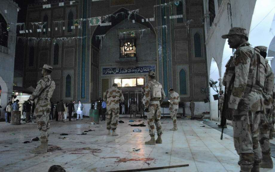 Pakistani para-military soldiers stand alert after a deadly suicide attack at the shrine of famous Sufi Lal Shahbaz Qalandar in Sehwan, Pakistan, Thursday, Feb. 16, 2017. An Islamic State suicide bomber targeted worshippers at a famous shrine in southern Pakistan on Thursday, killing dozens of worshippers and left hundreds of people wounded, officials said. (AP Photo/Pervez Masih) Photo: Pervez Masih, STR / Copyright 2017 The Associated Press. All rights reserved.