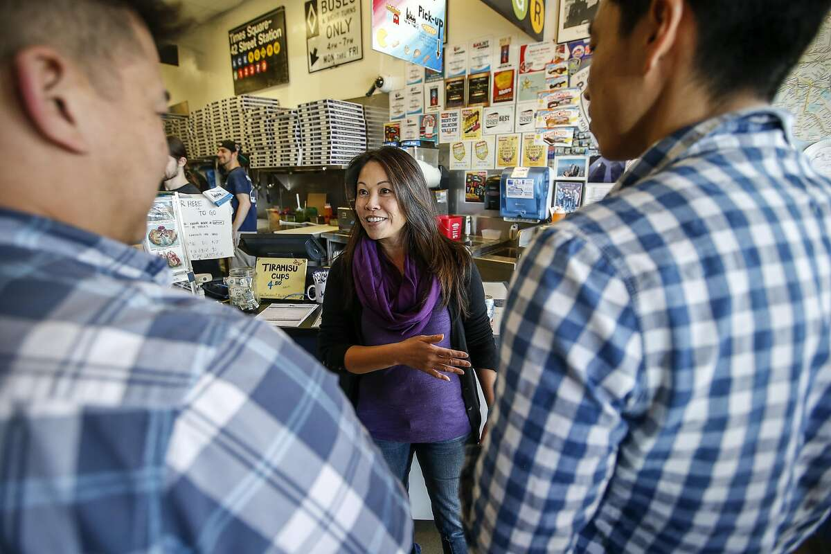 Marguerite Lee co-owner of A Slice of New York talks with customers during lunch time on Thursday, Feb. 16, 2017 in San Jose, California. A Slice of New York, a New York-style pizzeria is in the process of transitioning from a traditional owner structure to a cooperative that will create a democratic governance system with 10 employees becoming co-owners of the business.