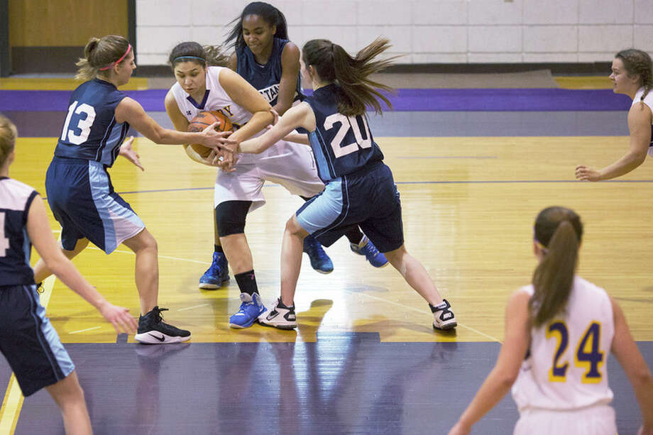THEOPHIL SYSLO   For the Daily News Calvary Baptist's Tamrah Konieczka fights for possession of the ball while being defended by West Highland Christian's Kate Kuehn, Kendall Burwell and Sarah Barber  in a game at Calvary Baptist Academy on Thursday.