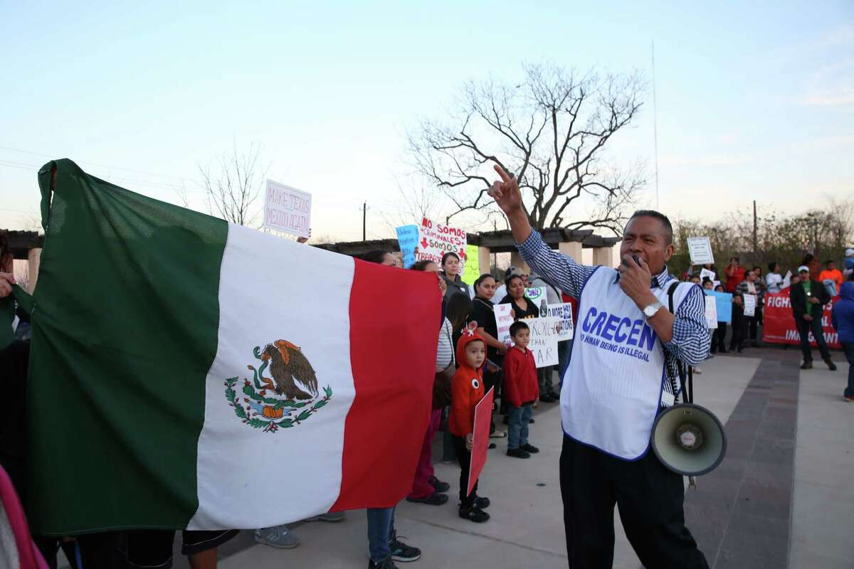 """Theodore Aguiluz, Executive Director of Centro de Recursos Centroamericanos, leads the rally with a megaphone at the """"Day Without Immigrants"""" protest at TGuadalupe Plaza on Thursday, February 16, in Houston."""