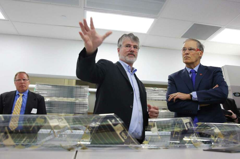 J. Devin MacKenzie, Director of the new Washington Clean Energy Testbeds, gives a tour of the 15,000 square foot facility to Governor Jay Inslee during an opening event, Thursday, Feb. 16, 2017.  Researchers at the facility will work on clean energy technology and innovation, including printable, low-cost solar cells, new battery systems and energy management software. Photo: GENNA MARTIN, SEATTLEPI.COM / SEATTLEPI.COM