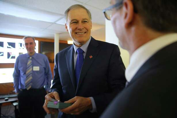 Governor Jay Inslee tours the new Washington Clean Energy Testbeds, during an opening event, Thursday, Feb. 16, 2017.  Researchers at the 15,000 square foot facility will work on clean energy technology and innovation, including printable, low-cost solar cells, new battery systems and energy management software.