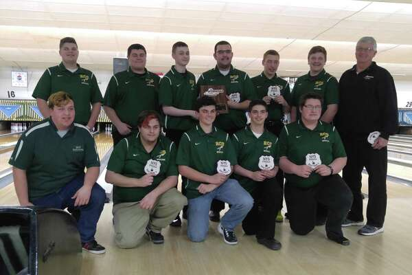 Members of the 2017 Section II Class B boys' bowling champion Ravena: Front row (from left), Steve Johnson, Nick Sabatino, Jack Morrow, Adam Wells, Justin Firstiun; back row, Noah Galusha, Michael Hotaling, Jered Taylor, Don Baker, Spencer Brown, Kolton Keeler, coach Gary Vanderzee. (Pete Dougherty/Times Union)