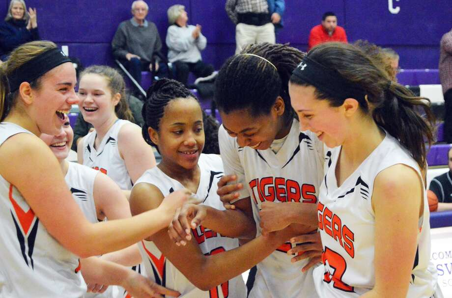 Edwardsville forward Criste'on Waters, second to right, celebrates with teammates.