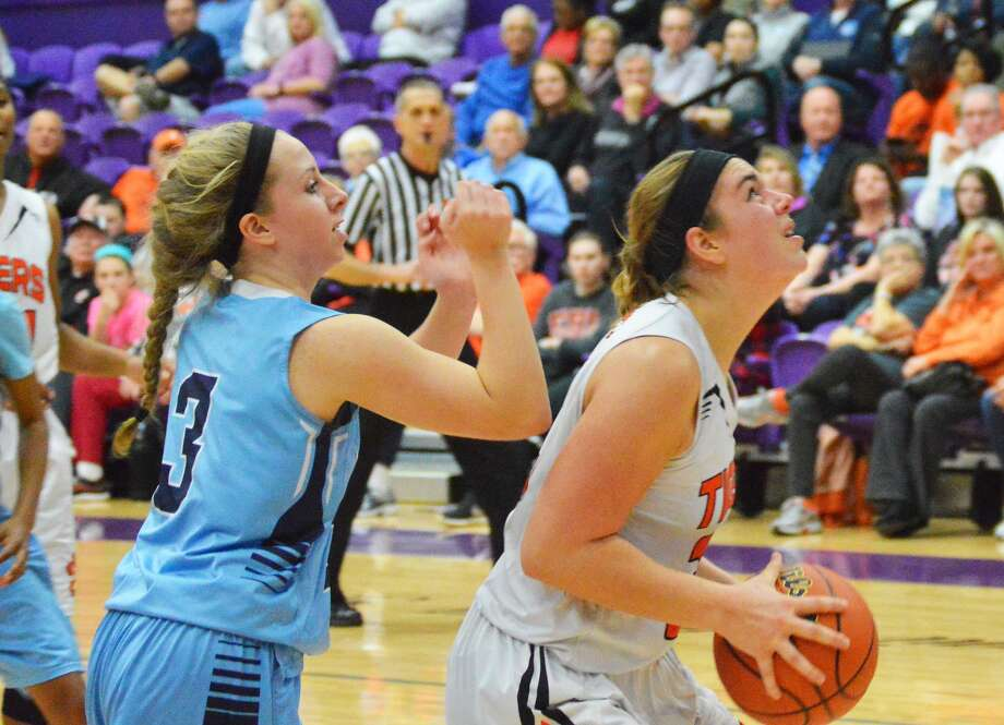 Edwardsville junior forward Rachel Pranger, right, goes up for a shot during the fourth quarter against Belleville East in the Class 4A Collinsville Regional championship game.