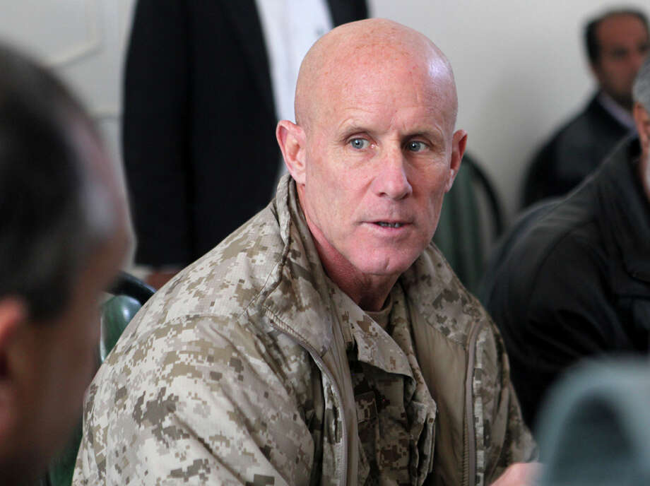 In this image provided by the U.S. Marine Corps, Vice Adm. Robert S. Harward, commanding officer of Combined Joint Interagency Task Force 435, speaks to an Afghan official during his visit to Zaranj, Afghanistan, Jan 6, 2011. Harward has turned down an offer to be President Donald Trump's new national security adviser, the latest blow to a new administration struggling to find its footing. A senior White House official said Feb. 16, 2017, that Harward had turned the offer down due to financial and family commitments. (Sgt. Shawn Coolman/U.S. Marine Corps via AP) ORG XMIT: WX122 Photo: Sgt. Shawn Coolman / Public Domain