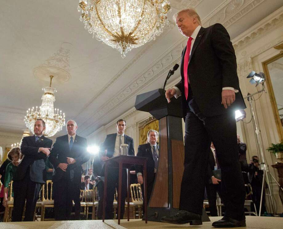 President Donald Trump walks away from his podium at the conclusion of a news conference in the East Room of the White House in Washington, Thursday, Feb. 16, 2017. Standing in the front row, from left are, White House Chief of Staff Reince Priebus, Vice President Mike Pence, senior adviser Jared Kushner and White House chief strategist Steve Bannon. (AP Photo/Pablo Martinez Monsivais) ORG XMIT: DCPM102 Photo: Pablo Martinez Monsivais / Copyright 2017 The Associated Press. All rights reserved.