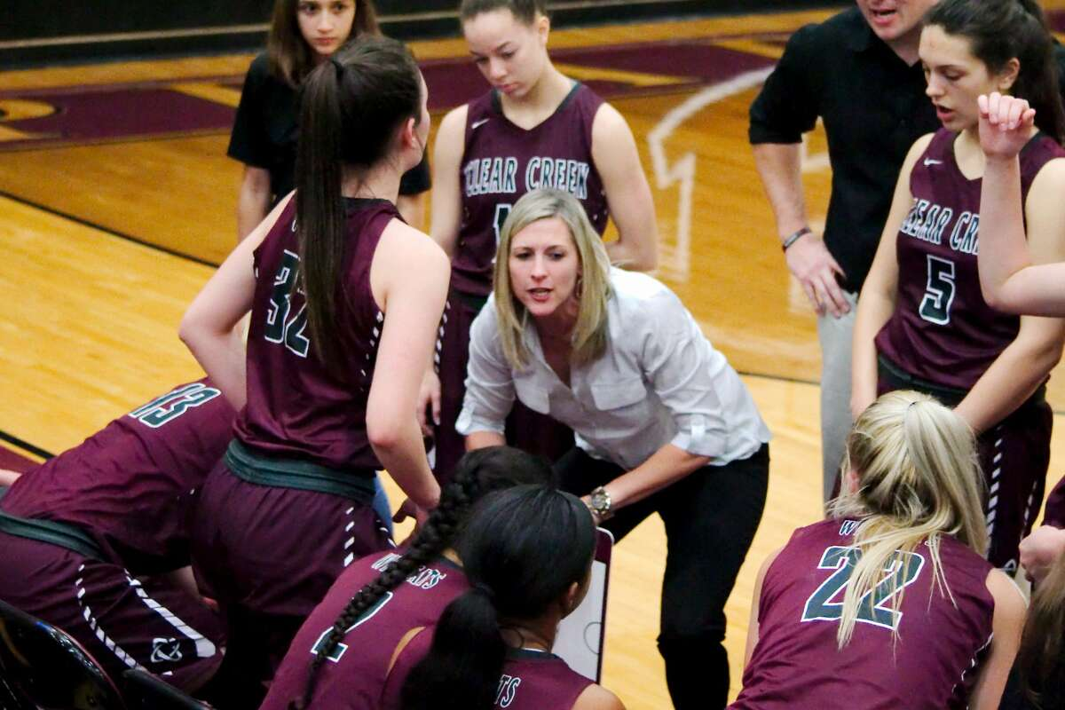 Clear Creek girls basketball coach Kristi Odom speaks to her team during a break in the game against Dobie Thursday, Feb. 15 at Pearland High School.