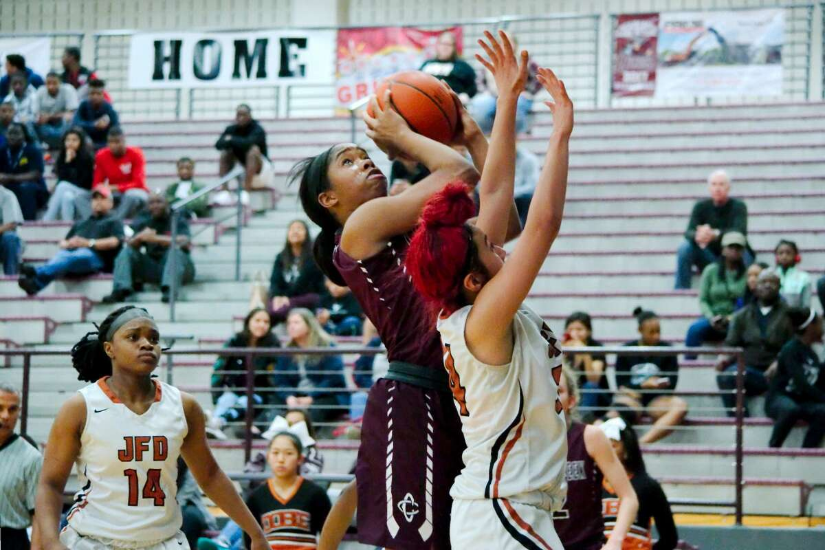 Clear Creek's Keondra White (1) muscles up a shot over Dobie's Shanyce CAbrales (24)