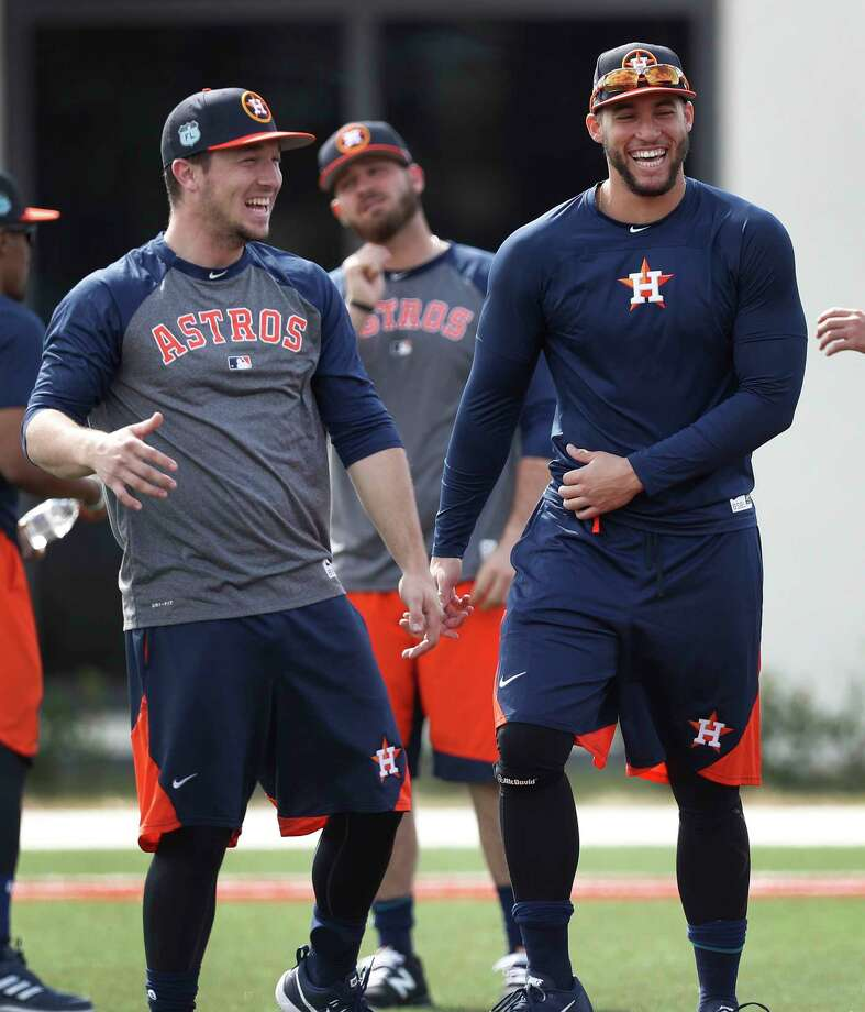 In the spring a young man's fancy lightly turns to … baseball as Astros outfielder George Springer, right, shares a laugh with infielder Alex Bregman as they prepare to work out with the position players at The Ballpark of the Palm Beaches. Photo: Karen Warren, Staff Photographer / 2017 Houston Chronicle