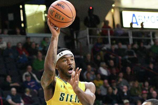 Siena's #15 Nico Clareth, top, gets a pass over Manhattan defenders #5 Tyler Wilson, left, and #3 Zavier Turner during Thursday's game at the Times Union Center Feb. 16, 2017 in Albany, NY.  (John Carl D'Annibale / Times Union)