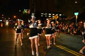 Participants in the WBCA IBC Youth Parade Under the Stars make their way down San Bernardo Avenue on Thursday, February 16, 2017.