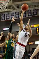 SPOKANE, WA - FEBRUARY 16:  Nigel Williams-Goss #5 of the Gonzaga Bulldogs puts up a shot against Nate Renfro #15 of the San Francisco Dons in the second half at McCarthey Athletic Center on February 16, 2017 in Spokane, Washington.  Gonzaga defeated San Francisco 96-61.  (Photo by William Mancebo/Getty Images)