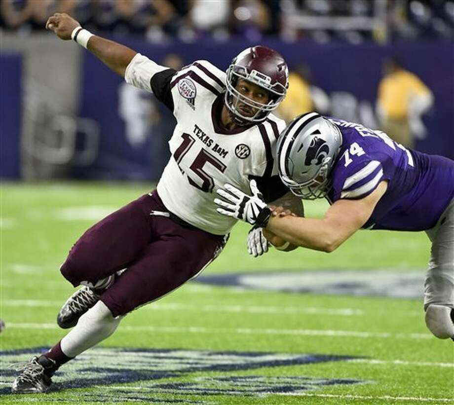 FILE - In this Dec. 28, 2016, file photo, Texas A&M's Myles Garrett (15) tries to get around Kansas State offensive lineman Scott Frantz during the second half of the Texas Bowl NCAA college football game in Houston. Garrett is among the top prospects in the upcoming NFL draft. (AP Photo/Eric Christian Smith, File) Photo: Eric Christian Smith, FRE / AP
