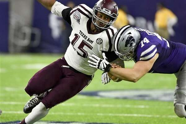 FILE - In this Dec. 28, 2016, file photo, Texas A&M's Myles Garrett (15) tries to get around Kansas State offensive lineman Scott Frantz during the second half of the Texas Bowl NCAA college football game in Houston. Garrett is among the top prospects in the upcoming NFL draft. (AP Photo/Eric Christian Smith, File)