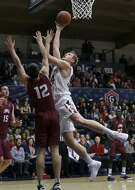 St. Mary's center Jock Landale, right, shoots against Loyola Marymount guard Steven Haney (12) during the first half of an NCAA college basketball game in Moraga, Calif., Thursday, Feb. 16, 2017. (AP Photo/Jeff Chiu)