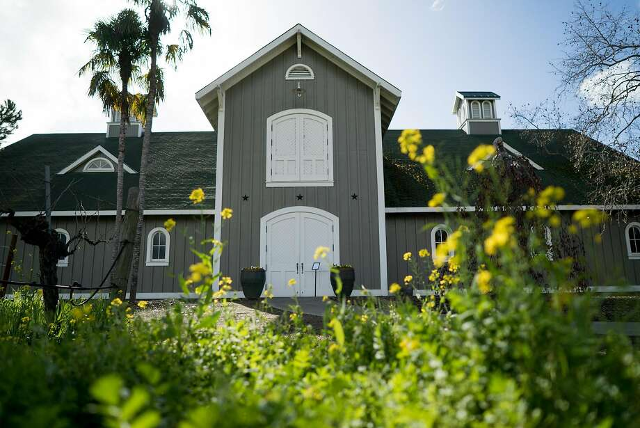 Vines and Mustard flowers surround Corison Winery, housed in a barn on Saint Helena Highway. Photo: James Tensuan, Special To The Chronicle