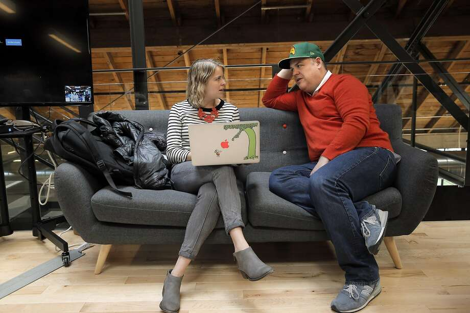 Lowell Goss, head of design at FiveStars, right, goes over some work with Samantha Berg, left, at the company's headquarters in San Francisco. Goss, a former top executive at Amazon, recalls with some sadness how the arrival of Walmart supercenters signaled the end of Main Street small businesses. Photo: Carlos Avila Gonzalez, The Chronicle