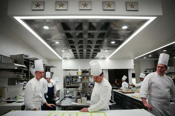 (l-r) Tyler Vorce and chef de cuisine David Breeden look over the menu in the kitchen at The French Laundry restaurant in Yountville, California, on Thursday, Feb. 16, 2017.