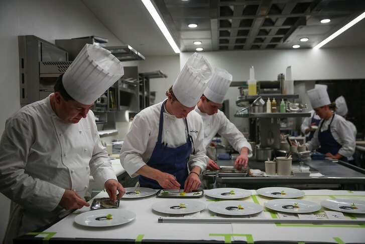 Chef de cuisine David Breeden, Bill Hendrix and Tyler Vorce prepare food in the kitchen at The French Laundry restaurant in Yountville, California, on Thursday, Feb. 16, 2017.