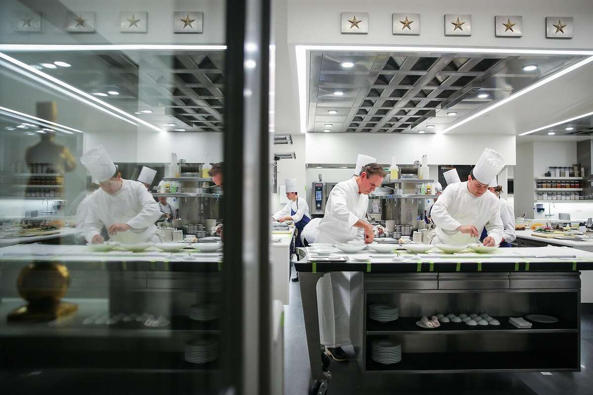 Chef Thomas Keller (left) and chef de cuisine David Breeden (right) plate dishes in the kitchen at The French Laundry restaurant in Yountville, California, on Thursday, Feb. 16, 2017.