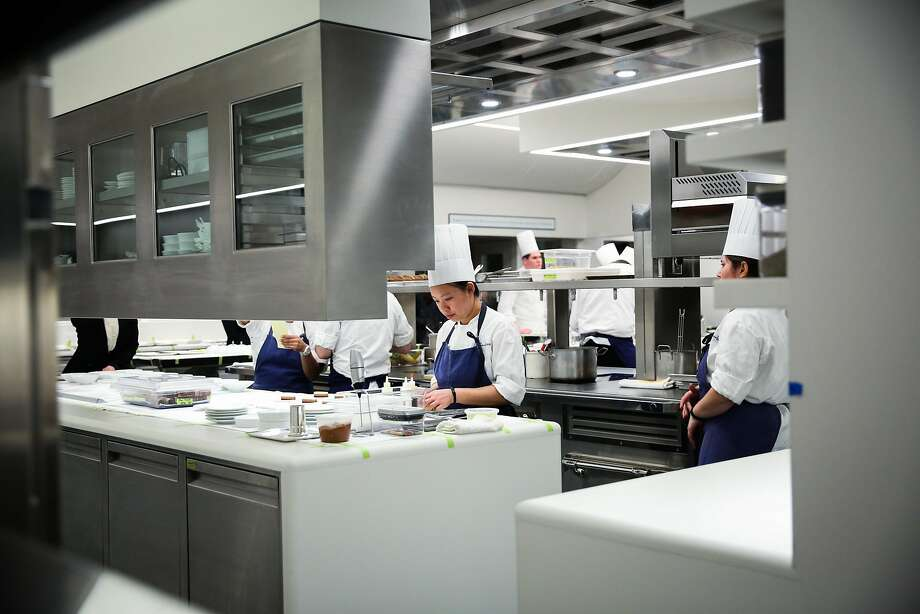 Pri Pichitpongchai (center) works in the new kitchen of the French Laundry. Photo: Gabrielle Lurie, The Chronicle
