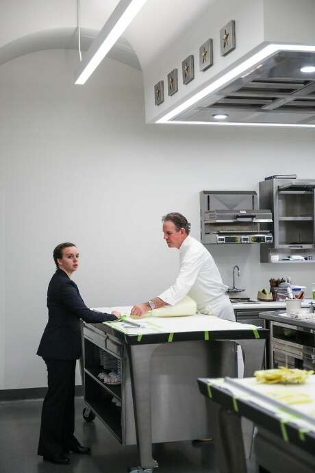 Chef Thomas Keller (right) chats with Emily McCandless (left) while cleaning up in the new kitchen of the French Laundry. Photo: Gabrielle Lurie, The Chronicle