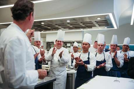 Chefs clap after head chef Thomas Keller (left) introduces the new kitchen at The French Laundry restaurant in Yountville, California, on Thursday, Feb. 16, 2017.
