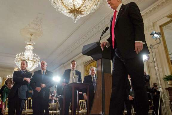 President Donald Trump walks away from his podium at the conclusion of a news conference in the East Room of the White House in Washington, Thursday, Feb. 16, 2017. Standing in the front row, from left are, White House Chief of Staff Reince Priebus, Vice President Mike Pence, senior adviser Jared Kushner and White House chief strategist Steve Bannon.