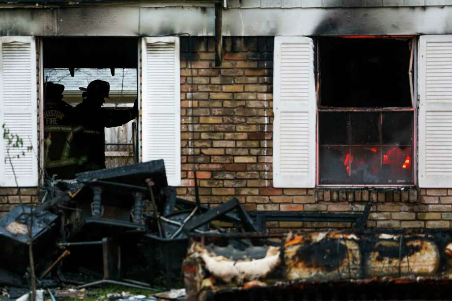 Three adults escaped a house fire on Hazden Street and Bentliff Drive early Friday, Feb. 17, 2017 in Houston. One firefighter suffered burns to his hands when he tried to make entry into the home. Photo: Michael Ciaglo, Houston Chronicle / Michael Ciaglo