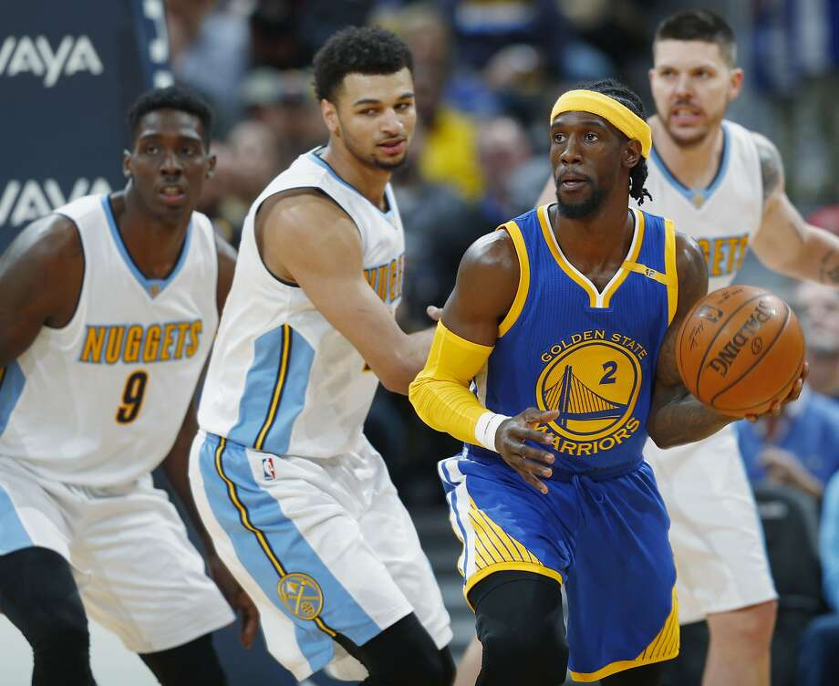 Golden State Warriors guard Briante Weber, right, looks to pass the ball as Denver Nuggets forward Johnny O'Bryant III, far left, and guard Jamal Murray defend in the second half of an NBA basketball game Monday, Feb. 13, 201, in Denver. The Nuggets won 132-110. (AP Photo/David Zalubowski) Photo: David Zalubowski, Associated Press