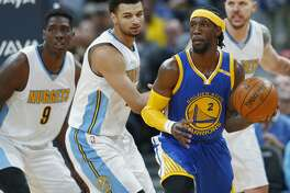 Golden State Warriors guard Briante Weber, right, looks to pass the ball as Denver Nuggets forward Johnny O'Bryant III, far left, and guard Jamal Murray defend in the second half of an NBA basketball game Monday, Feb. 13, 201, in Denver. The Nuggets won 132-110. (AP Photo/David Zalubowski)