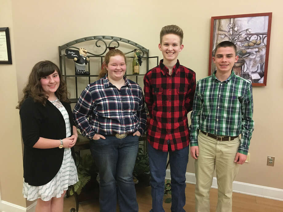 The Edwardsville Chapter of the Daughters of the American Revolution presents history awards to four local students. From left to right are:  Emily Williams, Hannah Klunk, William Kirk, and Luke Deakos. Emily Williams is in eighth grade student at St. Mary's and was nominated by Deborah Caulk.  Emily is the daughter of Christopher and Michelle Williams of Edwardsville. Hannah Klunk is an eighth grade student at Lincoln Middle School in Edwardsville and was nominated by Dr. Steve Stuart.  She is the daughter of Jeff and Deborah Klunk Clock of Moro. William Kirk is an eighth grade student at Liberty Middle School in Edwardsville. William was nominated by Rachael Harris. William is the son of Chris and Leah Kirk of Hamel. Luke Deakos is in eighth grade student at Saint Boniface school. Luke was nominated by Mrs. Litterst.  Luke is the son of Peter and Susan Deakos of Edwardsville. Photo: For The Intelligencer