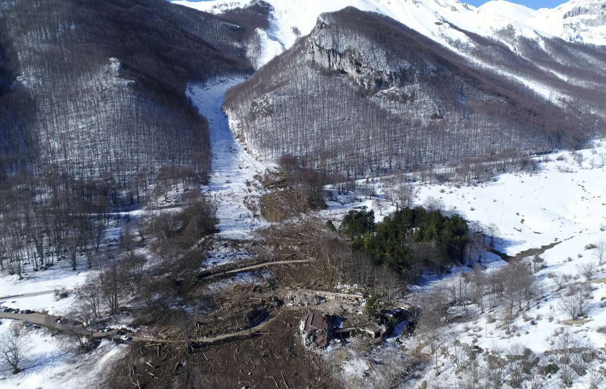 This frame taken from an aerial video shows the rubble of the Hotel Rigopiano which was buried by an avalanche in January, near Farindola, central Italy, Thursday, Feb. 16, 2017. The avalanche buried a hotel in central Italy under 60,000 tons of snow leaving 29 dead. (La Repubblica via AP)