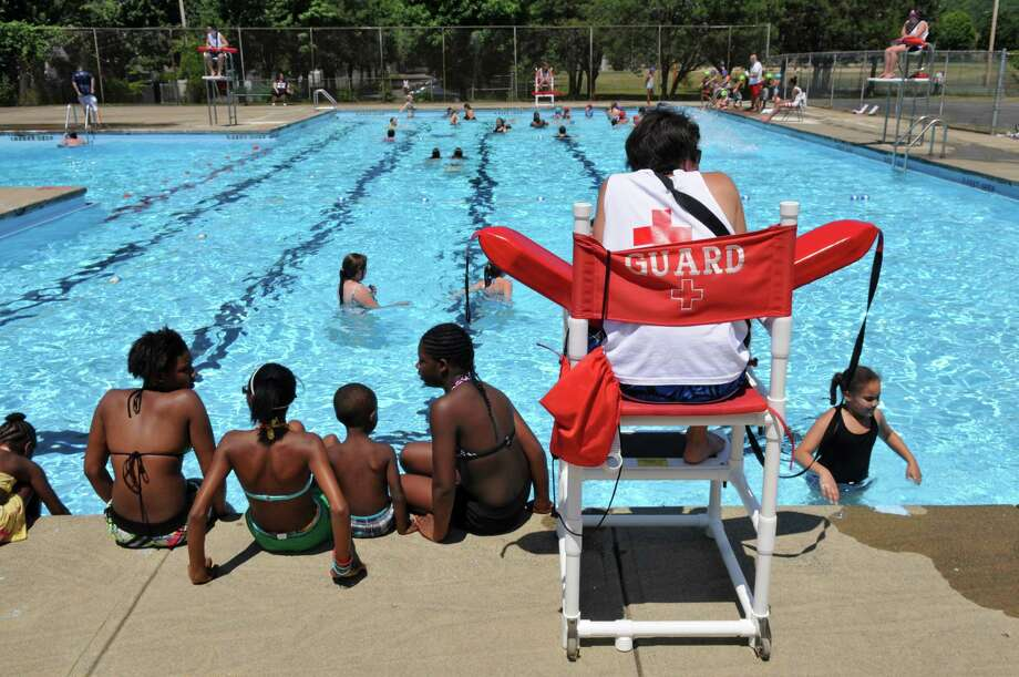 A lifeguard keeps an eye on swimmers  at the Knickerbacker Pool on Thursday June 28, 2012 in Troy, NY. The City of Troy has two municipal pools, which are open daily from 1 to 5:30. (Philip Kamrass / Times Union) Photo: Philip Kamrass / 00018283A