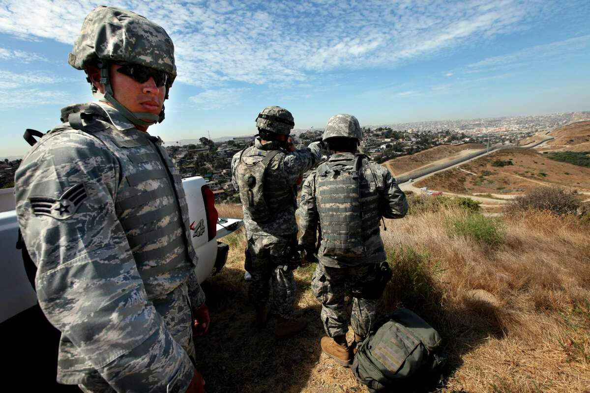National Guardsmen stand on patrol along the U.S.-Mexico border during a visit by California Gov. Arnold Schwarzenegger August 18, 2010 in San Ysidro, California.