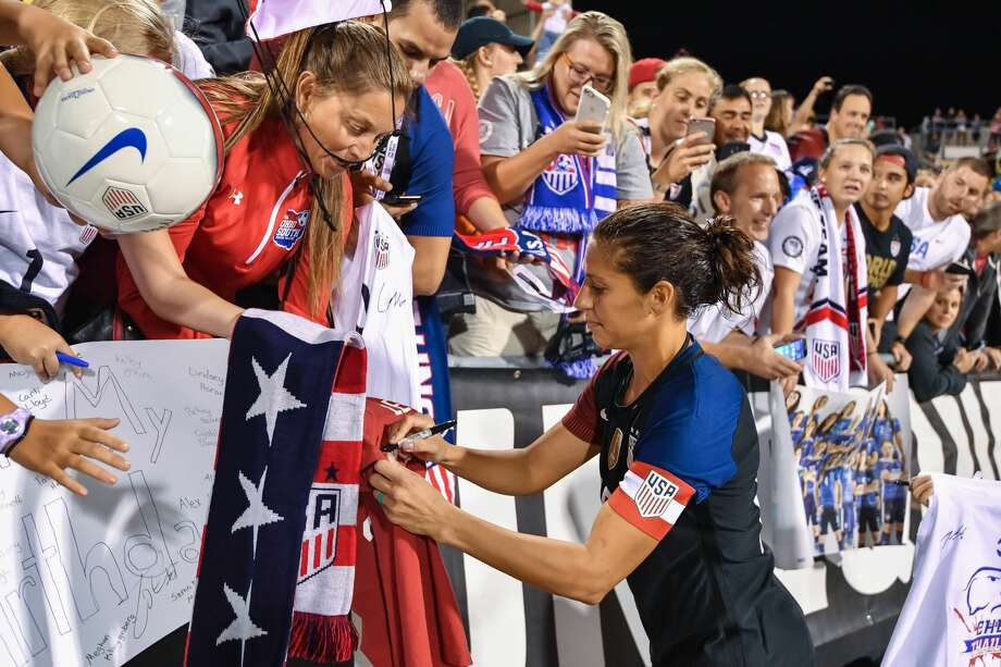 COLUMBUS, OH - SEPTEMBER 15:  Carli Lloyd #10 of the US Women's National Team signs autographs for fans after a game against Thailand on September 15, 2016 at MAPFRE Stadium in Columbus, Ohio. The United States defeated Thailand 9-0.  (Photo by Jamie Sabau/Getty Images) Photo: Jamie Sabau/Getty Images